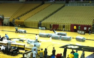 Staff from Mizzou Arena, MSHSAA and volunteers immediately begin changing over from basketball to wrestling.