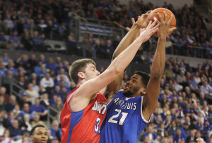 Saint Louis University Billikens Dwayne Evans has his shot blocked by Dayton Flyers Matt Kavanaugh in the first half at the Chaifetz Arena in St. Louis on March 5, 2014.   UPI/Bill Greenblatt