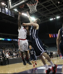 TJ White lays in the go-ahead basket with one second remaining.  (photo/NCAA.com)