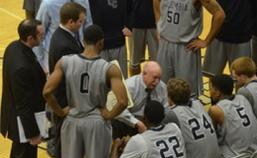 Bob Burchard huddles his team during a timeout, Thursday night in Kansas City. (photo/NAIA)