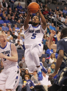 Saint Louis University Billikens Jordair Jett (5) runs through the pack in the first half as he scores two of his 16 points against the George Washington Colonials at the Chaifetz Arena in St. Louis on February 22, 2014.  Saint Louis won the game 66-59.  UPI/Bill Greenblatt