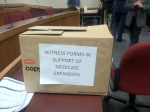 Michelle Trupiano points to more than 2000 witness forms in support of Medicaid expansion submitted at a Tuesday morning hearing on a House Republican Medicaid bill as evidence of Missourians' support for Medicaid expansion.