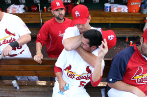 St. Louis Cardinals pitcher Adam Wainwright playfully puts fellow pitcher Joe Kelly in a headlock on the bench before a game against the Kansas City Royals at Busch Stadium in St. Louis on June 15, 2012. UPI/Bill Greenblatt