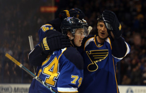 St. Louis Blues teammates skate in to congratulate T.J. Oshie (74) after he scored a goal against the Phoenix Coyotes in the first period at the Scottrade Center in St. Louis on January 14, 2014.   UPI/Bill Greenblatt