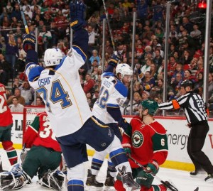 Blues forward T.J. Oshie celebrates his goal as the red lamps go on.  (photo, NHL.com)