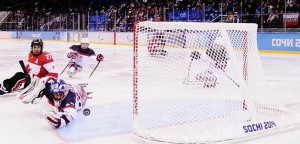 USA's Steve Case reaches to his left as a shot goes wide of the net (photo/courtesy USA Hockey)