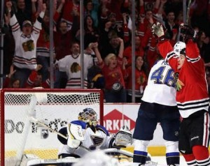 Andrew Shaw of the Chicago Blackhawks celebrates his goal as Ryan Miller looks on (NHL.com)
