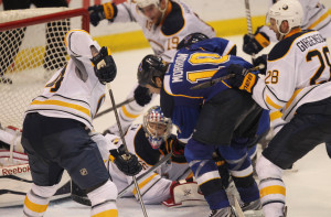 St. Louis Blues Brenden Morrow pokes the puck past the sprawling Buffalo Sabres goaltender Nathan Lieuwen in the third period at the Scottrade Center in St. Louis on April 3, 2014. St. Louis won the game 2-1.    UPI/Bill Greenblatt