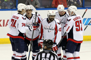 Washington Capitals Alex Ocechkin (8) of Russia celebrates his 50th goal of the season with his teammates in the first period of their game against the St.Louis Blues at the Scottrade Center in St. Louis on April 8, 2014.   UPI/Rob Cornforth