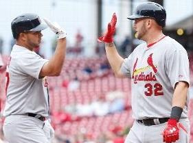 Matt Adams congratulates Jhonny Peralta after his two-run homer in the second (MLB photos)