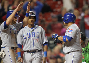 Chicago Cubs Wellington Castillo (R) is welcomed at home plate by Nate Schierholtz and Starlin Castro after hitting a three run home run in the 11th inning against the St. Louis Cardinals at Busch Stadium in St. Louis on April 11 2014. Chicago won the game 6-3.  UPI/Bill Greenblatt