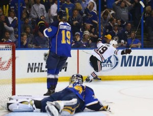 Jonathan Toews celebrates his game winner as Ryan Miller searches for the puck (photo/NHL.com)