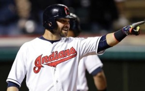 Nick Swisher points after scoring a run in the seventh inning. (MLB photos)