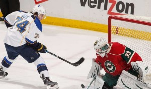 T.J. Oshie is stopped by Minnesota goalie John Curry (photo/NHL.com)