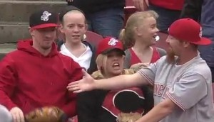 Cincinnati fans react after Matt Adams has a foul ball encounter with the fan on the left.