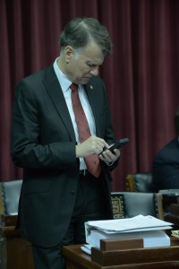 Representative Stanley Cox prepares for debate before final passage of the roughly 600-page criminal code bill, on his desk.  (photo courtesy; Tim Bommel, Missouri House Communications)