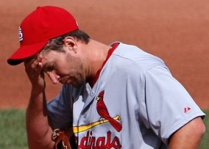 Adam Wainwright rubs his head after giving up the go ahead double in the seventh. (MLB photos)