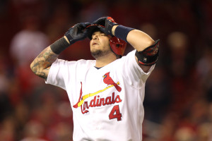 St. Louis Cardinals Yadier Molina grabs his helmet after lining out with men on base in the tenth inning against the Milwaukee Brewers at Busch Stadium in St. Louis on April 28, 2014. Milwaukee won the game 5-3 in 12 innings.  UPI/Bill Greenblatt