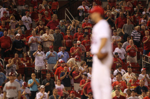 St. Louis Cardinals fans stand and clap as starting pitcher Adam Wainwright prepares to throw the last pitch of the game against the Arizona Diamondbacks at Busch Stadium in St. Louis on May 20, 2014. Wainwright gave up one hit in the 5-0 win. UPI/Bill Greenblatt