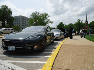 Tesla owners parked their cars in front of the Capitol Monday and spoke with lawmakers, urging them to oppose language that would stop Tesla's current business model in Missouri.