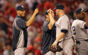 New York Yankees Derek Jeter joins teammates as they celebrate a 7-4 win over the St. Louis Cardinals at Busch Stadium in St. Louis on May 28, 2014. UPI/Bill Greenblatt