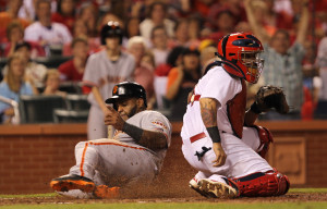 San Francisco Giants Pablo Sandoval slides safely into home as St. Louis Cardinals catcher Yadier Molina awaits the throw in the eighth inning at Busch Stadium in St. Louis on May 29, 2014. UPI/Bill Greenblatt