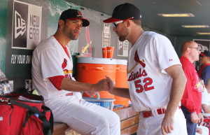 St. Louis Cardinals starting pitcher Jaime Garcia (L) is congratulated by pitcher Michael Wacha in the dugout after coming out of the game against the Atlanta Braves in the seventh inning at Busch Stadium in St. Louis on May 18, 2014.    UPI/Bill Greenblatt