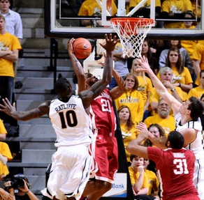 Ricardo Ratliffe goes to block a shot in a game between Missouri and Oklahoma in 2012 (photo/SoonerSports.com)