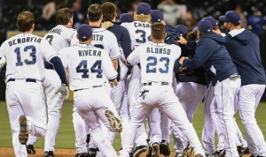 The San Diego Padres mob Will Venable after his game winning hit. (MLB photo)