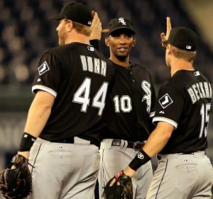 Adam Dunn, Alexei Ramirez and Gordon Beckham celebrate the Sox win over the Royals (photo/MLB)