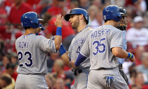 Kansas City Royals Alex Gordon (4) is greeted at home plate by teammates Nori Aoki (23) and Eric Hosmer (35)after hitting a three run home run  in the fifth inning against the St. Louis Cardinals at Busch Stadium in St. Louis on June 3, 2014.     UPI/Bill Greenblatt