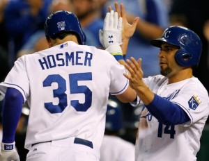 Eric Hosmer is greeted at home plate by Omar Infante after hitting a home run Tuesday night. (MLB/photo)