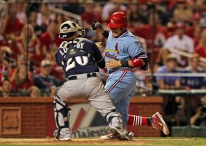 St. Louis Cardinals Yadier Molina is tagged out at homeplate by Milwaukee Brewers catcher Jonathan Lucroy as he tries to steal home in the eighth inning at Busch Stadium in St. Louis on August 5, 2012. St. Louis won the game 3-0.      UPI/Bill Greenblatt
