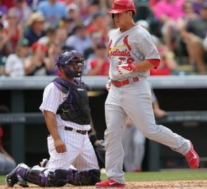 Cardinals rookie pitcher Marco Gonzales scores the Cardinals first run.  He got a no-decision in his  first major league start (photo/MLB)