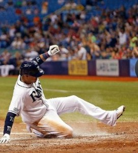 Yunel Escobar slides into home scoring a run for Tampa Bay (photo/MLB)