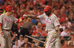Philadelphia Phillies Ryan Howard (R) pumps fists with Chase Utley as he arrives at home plate after hitting a two run home run in the sixth inning against the St. Louis Cardinals at Busch Stadium in St. Louis on June 18, 2014.  UPI/Bill Greenblatt