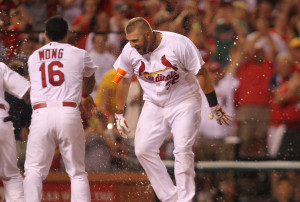 St. Louis Cardinals Matt Adams is greeted by teammates at home plate after hitting a two run walkoff home run in the ninth inning against the Pittsburgh Pirates at Busch Stadium in St. Louis on July 7, 2014. UPI/Bill Greenblatt