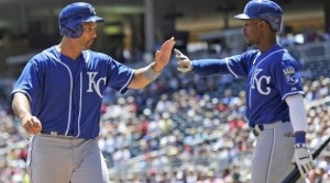 Raul Ibanez is greeted at home plate after scoring a run.  (photo/MLB)