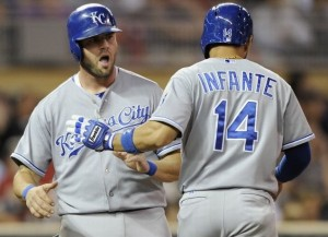 Mike Moustakas and Omar Infante celebrate a run during the Royals win over the Twins (photo/MLB)