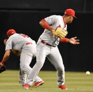 Kolten Wong and Oscar Taveres misplay a ball in the third inning.  It led to a San Diego double (photo/MLB)