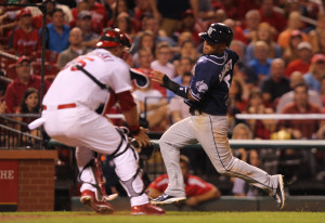 St. Louis Cardinals catcher A.J. Pierzynski reaches out to tag San Diego Padres Alexi Amarista for the out at home plate in the ninth inning at Busch Stadium in St. Louis on August 14, 2014. St. Louis won the game 4-3.   UPI/Bill Greenblatt