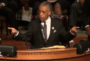 Al Sharpton asks those at the funeral of Michael Brown what they have done to prompt change since Brown's death.  (screencap courtesy; KTVI)