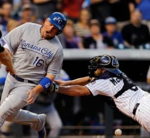 Billy Butler scores as catcher Michael McKenry drops the ball. (photo/MLB)