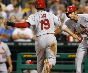 Jon Jay is greeted at home by Matt Carpenter after their both scored in the seventh (photo/MLB)