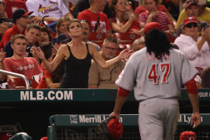 A woman taunts Cincinnati Reds starting pitcher Johnny Cueto as he comes out of the game against the St. Louis Cardinals in the sixth inning at Busch Stadium in St. Louis on August 20, 2014. UPI/Bill Greenblatt