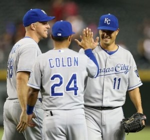 Jeremy Guthrie is congratulated by teammates after pitching a complete game. (photo/MLB)