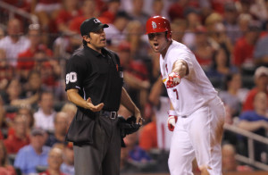 St. Louis Cardinals Matt Holliday argues a called third strike with home plate umpire Mark Ripperger in the seventh inning against the Boston Red Sox at Busch Stadium in St. Louis on August 5, 2014. Holliday was ejected from the game. UPI/Bill Greenblatt