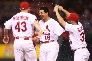 St. Louis Cardinals Jon Jay is soaked with water by teammates after being hit by a Cincinnati Reds J.J. Hoover pitch with bases loaded in the ninth inning at Busch Stadium in St. Louis on August 19, 2014. St. Louis won the game 5-4.      UPI/Bill Greenblatt