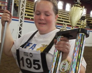 Kimberlee Gieseker of Holliday shows off one of her many trophies from the