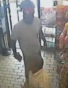Ferguson Police say this is convenience store video of a strong-armed robbery that Michael Brown was a suspect in, that happened about ten minutes before he was fatally shot by Ferguson Darren Wilson.